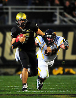 18 September 08: Colorado quarterback Cody Hawkins rushes against West Virginia. Attempting to tackle Hawkins is defensive lineman Pat Liebig. The Colorado Buffaloes defeated the West Virginia Mountaineers 17-14 in overtime at Folsom Field in Boulder, Colorado. For Editorial Use Only.
