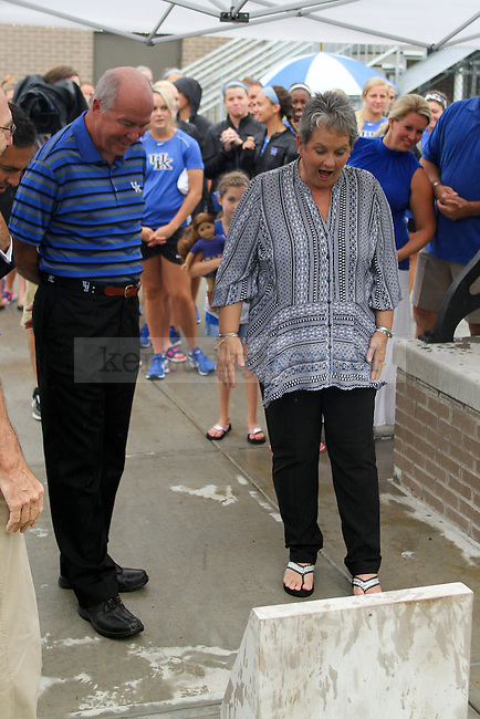 """Wendell and Vickie Bell read a plaque that dedicates the """"Victory Bell"""" to all their hard work during the dedication ceremony of the Wendell and Vickie Bell Soccer Complex in Lexington, Ky., on Sunday, August 31, 2014. Photo by Jonathan Krueger 