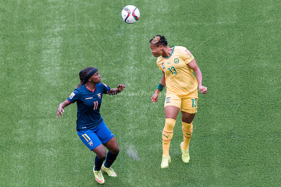 June 8, 2015: Cathy BOU NDJOUH of Cameroon heads the ball during a Group C match at the FIFA Women's World Cup Canada 2015 between Cameroon and Ecuador at BC Place Stadium on 8 June 2015 in Vancouver, Canada. Sydney Low/AsteriskImages