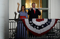 United States President Donald J. Trump and First Lady Melania Trump react from the Truman Balcony of the White House during a fireworks display in Washington, D.C., U.S., on Wednesday, July 4, 2018. Trump's campaign won the technical knockout of a lawsuit filed by two Democratic National Committee donors and a DNC staffer who accused it of colluding with Russian to publish compromising information about the Clinton campaign on WikiLeaks that included details about their lives. <br /> CAP/MPI/RS<br /> &copy;RS/MPI/Capital Pictures