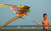 A flies a colorful dragon kite along the windy beaches of Sullivan's Island, near Charleston, SC.