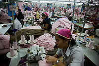 July 08, 2009 - Phnom Penh, Cambodia. Garment factory workers. © Nicolas Axelrod / Ruom
