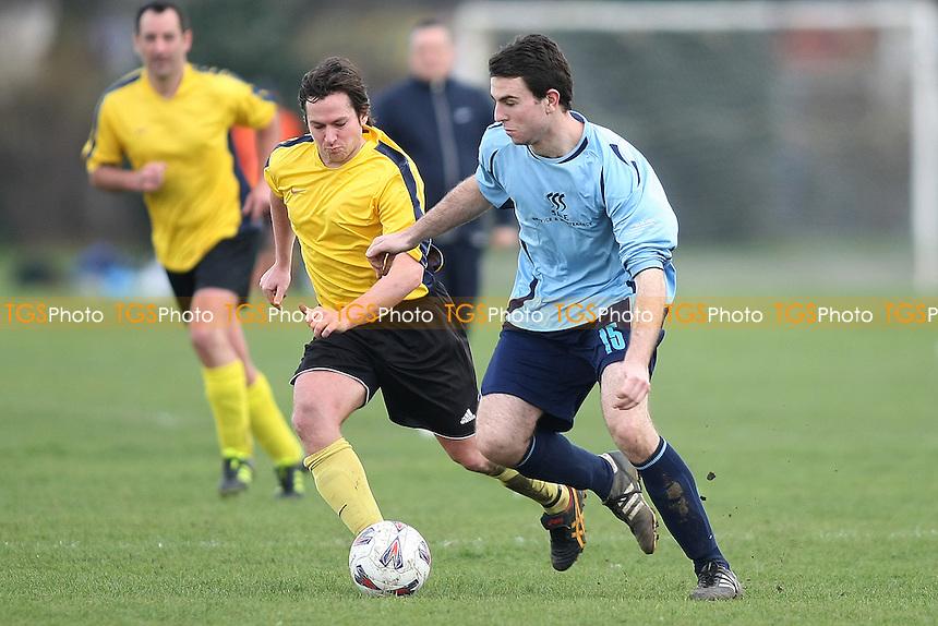 Manor House (Blue) v Sungate (Yellow) - Essex Sunday Corinthian League Football -Barking Park 18/03/12 - MANDATORY CREDIT: George Phillipou/TGSPHOTO - Self billing applies where appropriate - 0845 094 6026 - contact@tgsphoto.co.uk - NO UNPAID USE.