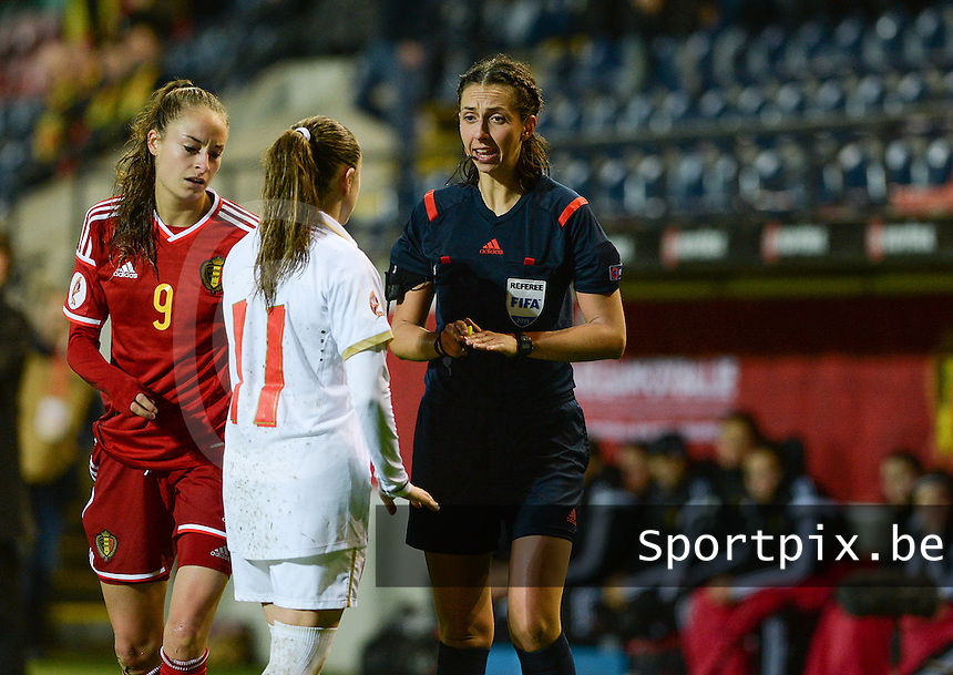 20151130 - LEUVEN ,  BELGIUM : Belgian Tessa Wullaert (9) and Serbian Vesna Smiljkovic (11) pictured with German referee Marija Kurtes (r) during the female soccer game between the Belgian Red Flames and Serbia , the third game in the qualification for the European Championship in The Netherlands 2017  , Monday 30 November 2015 at Stadion Den Dreef  in Leuven , Belgium. PHOTO DAVID CATRY