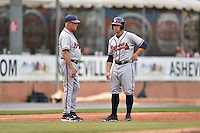 Rome Braves right fielder Braxton Davidson (24) talks with manager Randy Ingle (12) during a game against the Asheville Tourists on May 16, 2015 in Asheville, North Carolina. The Braves defeated the Tourists 6-3. (Tony Farlow/Four Seam Images)