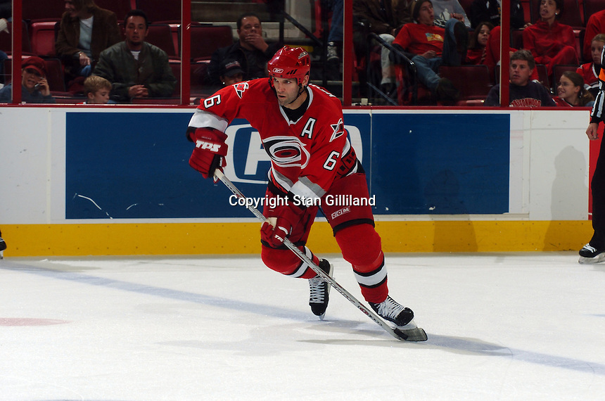 Carolina Hurricanes' Bret Hedican brings the puck up the ice during a game with the Tampa Bay Lightning Sunday, Nov. 20, 2005 in Raleigh, NC.  Tampa Bay won 5-2.