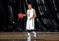 Florida International University guard Phil Taylor (11) plays against Florida Memorial University in an exhibition game .  FIU won the game 86-69 on November 9, 2011 at Miami, Florida. .