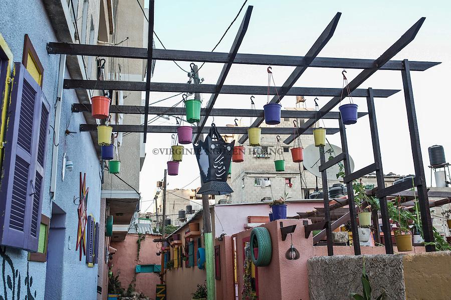 GAZA, Zaytoun: Some flower pots hanging over the street of Mohammed Al Saedy. 14/08/15<br /> <br /> GAZA , Zaytoun : Des pots de fleurs accroch&eacute;s au-dessus de la rue de Mohammed Al Saedi. 14/08/15
