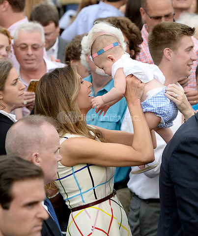 First Lady Melania Trump holds a baby during the Congressional Picnic on the South Lawn  of the White House in Washington, DC, on June 22, 2017. <br /> Credit: Olivier Douliery - Pool via CNP /MediaPunch