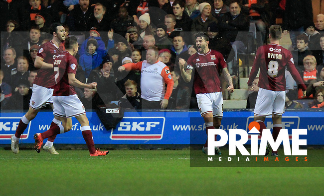 Marc Richards of Northampton celebrates his goal and Northampton's third during the Sky Bet League 2 match between Luton Town and Northampton Town at Kenilworth Road, Luton, England on 12 December 2015. Photo by Liam Smith/Prime Media Images.