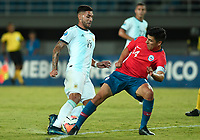 PEREIRA - COLOMBIA, 24-01-2020: Tomas Alarcon de Chile disputa el balón con Lautaro Bustos de Argentina durante partido entre Chile y Argentina por la fecha 3, grupo A, del CONMEBOL Preolímpico Colombia 2020 jugado en el estadio Hernán Ramírez Villegas de Pereira, Colombia. / Tomas Alarcon of Chile fights the ball with Lautaro Bustos of Argentina during the match between Chile and Argentina for the date 3, group A, for the CONMEBOL Pre-Olympic Tournament Colombia 2020 played at Hernan Ramirez Villegas stadium in Pereira, Colombia. Photos: VizzorImage / Julian Medina / Cont