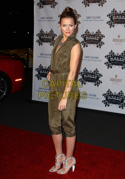 SHANTEL VANSANTEN .The Rally for Kids with Cancer Scavenger Cup Press Conference held at the Petersen Automotive Museum, Los Angeles, California, USA,  .24th May 2010..full length green khaki jumpsuit catsuit hand on hip cropped silk grey gray cut out sandals .CAP/ADM/TC.©T. Conrad/AdMedia/Capital Pictures.