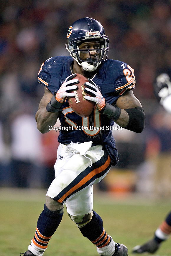 Running back Thomas Jones #20 of the Chicago Bears looks for a receiver during an NFL football game against the Carolina Panthers in their NFC Divisional Playoff game on January 15, 2006 at Soldier Field in Chicago, Illinois. The Panthers defeated the Bears 29-21. (Photo by David Stluka)