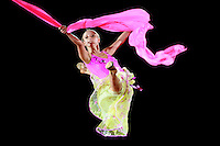 Vera Sessina of Russia split leaps with chiffon scarf during gala at 2007 Portimao World Cup of Rhythmic Gymnastics on April 29, 2006.  (Photo by Tom Theobald)..