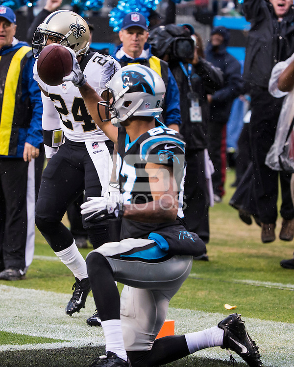 The Carolina Panthers played the New Orleans Saints for supremacy in the NFC South.  December 22, 2013 at Bank of America Stadium.  The Panthers scored the winning touchdown with 23 seconds left in the game to give them the opportunity to clinch the NFC South with a win next week.  Carolina Panthers wide receiver Domenik Hixon (87) holds up the ball after catching the game winning touchdown against the New Orleans Saints.
