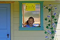 Boy in window of shed at community Garden, Yarmouth ME
