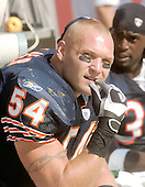 All-Pro Chicago Bear linebacker Brian Urlacher (54) nervously watches the offense from the bench during his team's visit to FedEx Field to play the Washington Redskins in Landover, Maryland on September 11, 2005.  The Redskins won the game 9 - 7.Credit: Ron Sachs / CNP