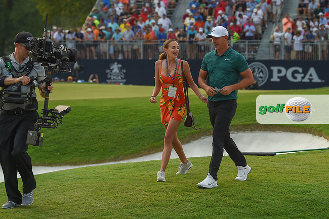 Jena sims and Brooks Koepka (USA) are all smiles as they depart the green on 18 after winning the 100th PGA Championship at Bellerive Country Club, St. Louis, Missouri. 8/12/2018.<br /> Picture: Golffile | Ken Murray<br /> <br /> All photo usage must carry mandatory copyright credit (© Golffile | Ken Murray)