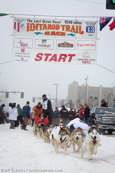 Mike Ellis and team leave the ceremonial start line at 4th Avenue and D street in downtown Anchorage during the 2013 Iditarod race. Photo by Jim R. Kohl/IditarodPhotos.com