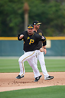 Pittsburgh Pirates Garth Brooks (7) running the bases in a drill as coach Brian Esposito looks on during the teams first Spring Training practice on February 18, 2019 at Pirate City in Bradenton, Florida.  (Mike Janes/Four Seam Images)