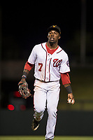 Salt River Rafters center fielder Daniel Johnson (7), of the Washington Nationals organization, tosses a ball to a fan as he jogs off the field between innings of an Arizona Fall League game against the Scottsdale Scorpions at Salt River Fields at Talking Stick on October 11, 2018 in Scottsdale, Arizona. Salt River defeated Scottsdale 7-6. (Zachary Lucy/Four Seam Images)