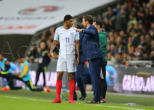 14th November 2017, Wembley Stadium, London, England; International football friendly, England versus Brazil; Marcus Rashford of England receives instruction off England Manager Gareth Southgate