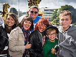 © Joel Goodman - 07973 332324 . 31 August 2013 . Rochdale , UK . L-R Shannon Wild (19) , Karen Wild (44) . Bryan Wild (45) , Andrea Barker (44) , Daniel Barker (11) and Matthew Barker (13) , all from Rochdale , all correct , enjoy the view from the balcony of the Town Hall . The Rochdale Feel Good Festival . Photo credit : Joel Goodman