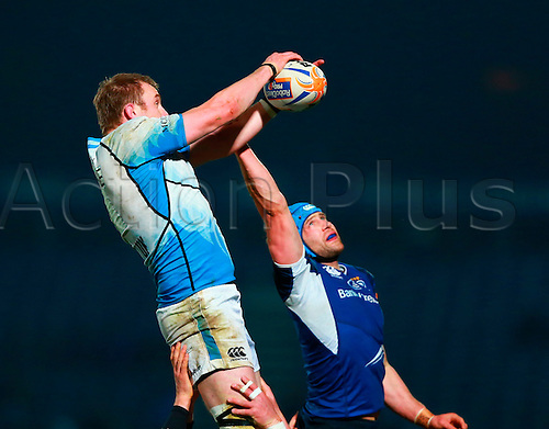 23.03.2013 Dublin, Ireland. Alastair Kellock (Captain Glasgow) gets the ball ahead of Kevin McLaughlin (Leinster) during the RaboDirect Pro12 game between Leinster and Glasgow from the RDS Arena.