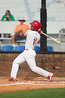 Eliezer Alvarez (11) of the Johnson City Cardinals follows through on his swing against the Bristol Pirates at Howard Johnson Field at Cardinal Park on July 6, 2015 in Johnson City, Tennessee.  The Pirates defeated the Cardinals 2-0 in game one of a double-header. (Brian Westerholt/Four Seam Images)
