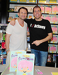 "BAL HARBOUR, FL - SEPTEMBER 17: Christian Slater (L) pose for a picture with Perez Hilton (R) during his book signing ""The Boy With The Pink Hair'' at Books and Books on September 17, 2011 in Bal Harbour, Florida. (Photo by Johnny Louis/jlnphotography.com)"