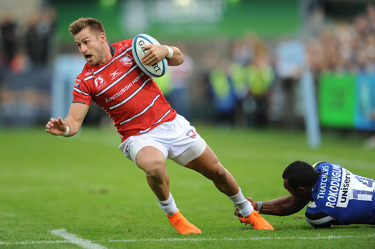 Henry Trinder of Gloucester Rugby evades the tackle of Semesa Rokoduguni of Bath Rugby during the Gallagher Premiership Rugby match between Bath Rugby and Gloucester Rugby at The Recreation Ground on Saturday 8th September 2018 (Photo by Rob Munro/Stewart Communications)