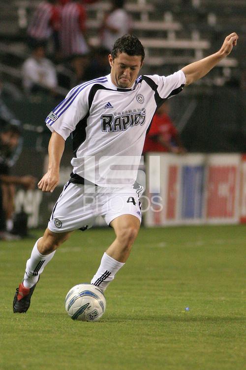 Colorado Rapids midfielder (4) Dan Gargan hits a cross pass. The Colorado Rapids defeated Chivas USA 3-1 at the Home Depot Center in Carson, CA on September 24, 2005