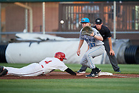 Hudson Valley Renegades first baseman Jacson McGowan (37) waits to receive a throw in front of first base umpire Sean Cassidy as Kyle Marinconz (4) dives back towards the base on a pick off attempt during a game against the Auburn Doubledays on September 5, 2018 at Falcon Park in Auburn, New York.  Hudson Valley defeated Auburn 11-5.  (Mike Janes/Four Seam Images)