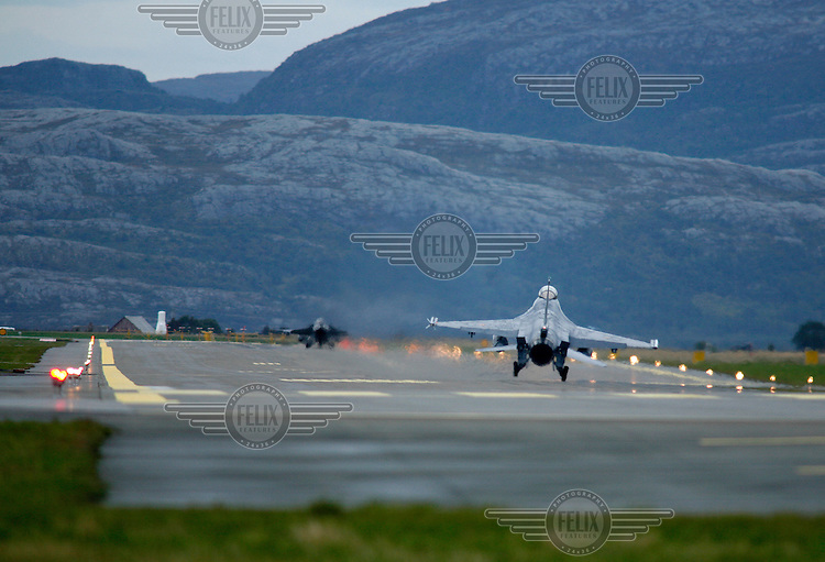 Lockheed Martin F-16 Fighting Falcon landing. BOLD AVENGER 2007 (BAR 07), a NATO  air exercise at Ørland Main Air Station, Norway. BAR 07 involved air forces from 13 NATO member nations: Belgium, Canada, the Czech Republic, France, Germany, Greece, Norway, Poland, Romania, Spain, Turkey, the United Kingdom and the United States of America. The exercise was designed to provide training for units in tactical air operations, involving over 100 aircraft, including combat, tanker and airborne early warning aircraft and about 1,450 personnel.