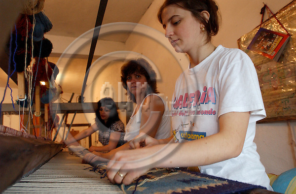 Zogaj-Shkodra/Shkoder-Albania - August 06, 2004---Female weavers working on a carpet at a loom in a private weaving mill;  project area of GTZ-Wiram-Albania (German Technical Cooperation, Deutsche Gesellschaft fuer Technische Zusammenarbeit (GTZ) GmbH); economy-industry-enterprise-labour-people---Photo: Horst Wagner/eup-images
