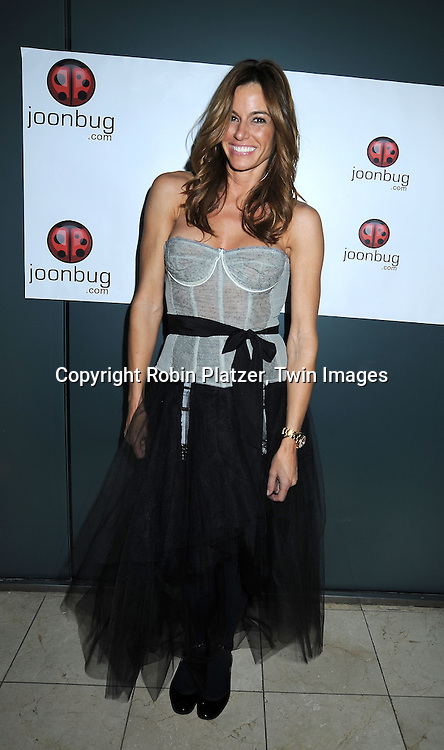 Kelly Killoren Bensimon in Geminelli gray corset and skirt