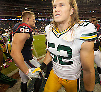 Green Bay Packers linebacker Clay Matthews and Houston Texans defensive tackle JJ Watt exchange handshakes as the Packers defeated the Texans 42-24 in Reliant Stadium on Oct. 14, 2012