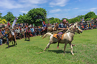 March 29, 2016 - Wainyapu (Indonesia). A rider starts a new wave of attacks. A skilled rider can duck an incoming spear and the very best of them can catch the spear in mid-air. For the less agile, the spears, though blunted, can spill blood, which the Sumbanese believe will fertilize the land and produce a better harvest. © Thomas Cristofoletti / Ruom