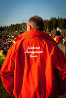Member of the Jamboree Management Team standing close to the audience. Photo: André Jörg/ Scouterna