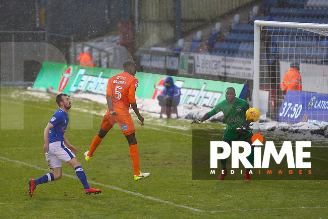 Northampton Town's Leon Barnett (C) watches as his header just goes wide during the Sky Bet League 1 match between Oldham Athletic and Northampton Town at Boundary Park, Oldham, England on 9 December 2017. Photo by Juel Miah / PRiME Media Images.