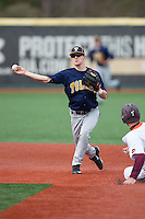 Toledo Rockets shortstop Matt Hansen (5) turns a double play against the Virginia Tech Hokies at The Ripken Experience on February 28, 2015 in Myrtle Beach, South Carolina.  The Hokies defeated the Rockets 1-0 in 10 innings.  (Brian Westerholt/Four Seam Images)