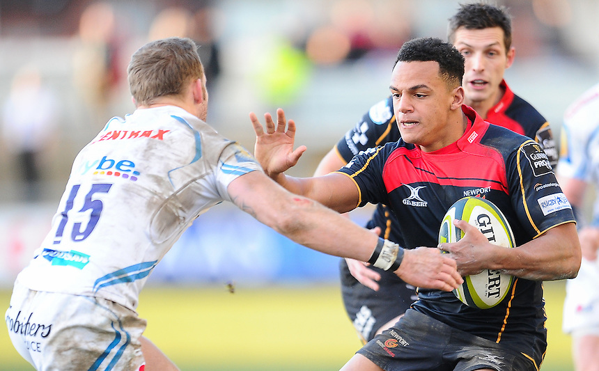 Newport Gwent Dragons' Ashton Hewitt is tackled by Exeter Chiefs' Byron McGuigan<br /> <br /> Photographer Craig Thomas/CameraSport<br /> <br /> Rugby Union - European Rugby Challenge Cup Pool 3 - Newport Gwent Dragons v Exeter Chiefs - Sunday 1st February  2015 - Rodney Parade - Newport <br /> <br /> &copy; CameraSport - 43 Linden Ave. Countesthorpe. Leicester. England. LE8 5PG - Tel: +44 (0) 116 277 4147 - admin@camerasport.com - www.camerasport.com