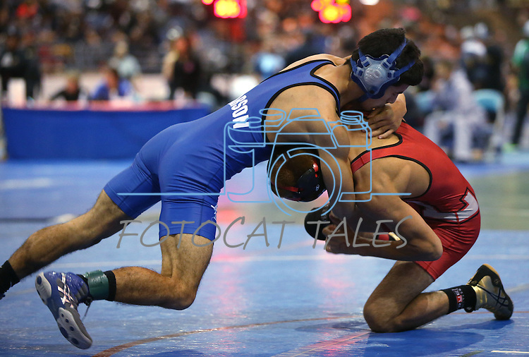 Carson's Anthony Estrada competes against Jorge Robles, of Lincoln, Ca., during the annual Sierra Nevada Classic wrestling tournament in Reno, Nev., on Thursday, Dec. 27, 2013. <br /> Photo by Cathleen Allison