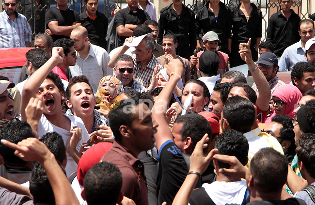 "Egyptian members of 6th April movement celebrate the releasing of four members of the movement in front of Attorney General's Office in Cairo on April 29, 2013. Three of the group's members and one other protester have been detained following a demonstration against police violence outside the residence of Egypt's interior minister in late March. They were arrested for chanting against the interior ministry and describing it as a ""prostitute"". Photo by Tareq Gabas"