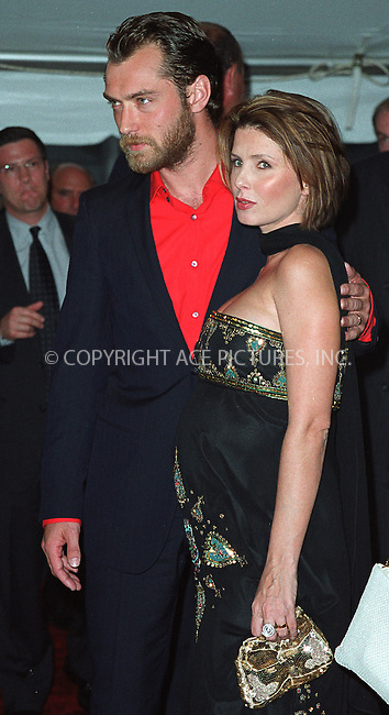 "Jude Law with wife Sadie Frost attending a special screening of ""Road to Perditon"" to benefit the Association of the HITWG Camps and the International Rescue Committee. New York, July 9, 2002.  Please byline: Alecsey Boldeskul/NY Photo Press.   ..*PAY-PER-USE*      ....NY Photo Press:  ..phone (646) 267-6913;   ..e-mail: info@nyphotopress.com"