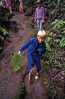 A family hiking the pihea trail on the Island of Kauai