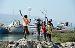 Boys fly kites in a Port-au-Prince neighborhood days after the January 12 earthquake that ravaged the Caribbean island nation.