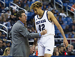 Nevada head coach Steve Alford  talks to Nevada forward K.J. Hymes (42) during the second half of an NCAA college basketball game agianst Colorado Christianin Reno, Nev., Wednesday, Oct. 30, 2019