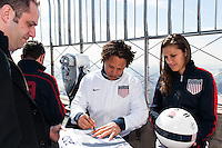 Former men's national team player Cobi Jones autographs a 100th anniversary jersey on the observation deck of the Empire State Building during the centennial celebration of U. S. Soccer in New York, NY, on April 05, 2013.