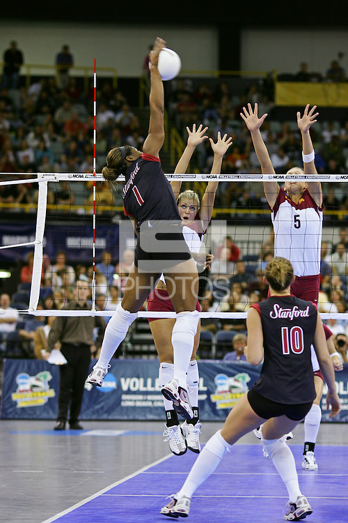 18 December 2004: Stanford Cardinal Ogonna Nnamani during Stanford's  30-23, 30-27, 30-21 victory over Minnesota in the 2004 NCAA Women's Volleyball National Championships in Long Beach, CA. Stanford won their sixth women's volleyball title in school history. Nnamani was named the tournament's Most Outstanding Player and broke the tournament record for kills.<br />